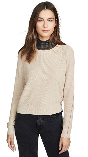 A brown or beige sweater